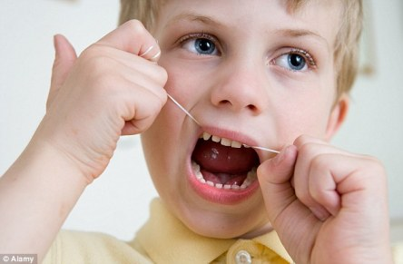 flossing-teeth-pic-boy-alamy
